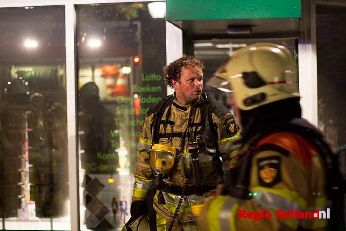 Brand in boekhandel aan de Marktstraat - Foto: Pim Haarsma