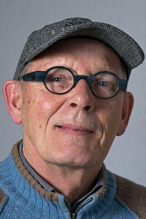 Man met hoofddeksel Flip Huisman - Foto: Paul Scholten