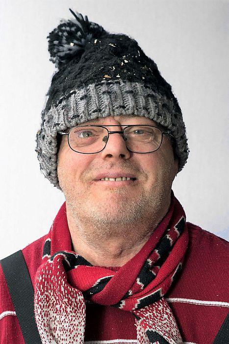 Man met hoofddeksel  Henk Schuurman - Foto: Paul Scholten