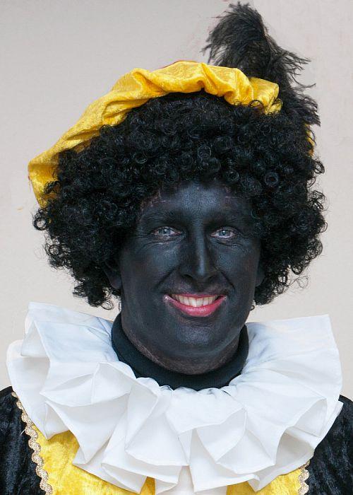 Man met hoofddeksel: deze keer Zwarte Piet - Foto: Paul Scholten