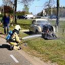 Saab oldtimer in de brand op kruispunt Driessen.